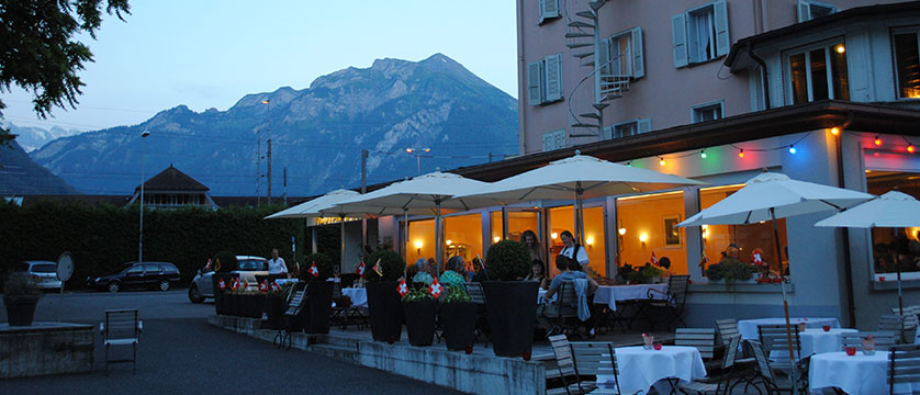 Hotel Du Lac, Interlaken, Bernese Oberland, Switzerland - al-fresco dining at the restaurant at dusk.jpg